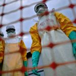 Healthcare workers wearing protective Ebola suits