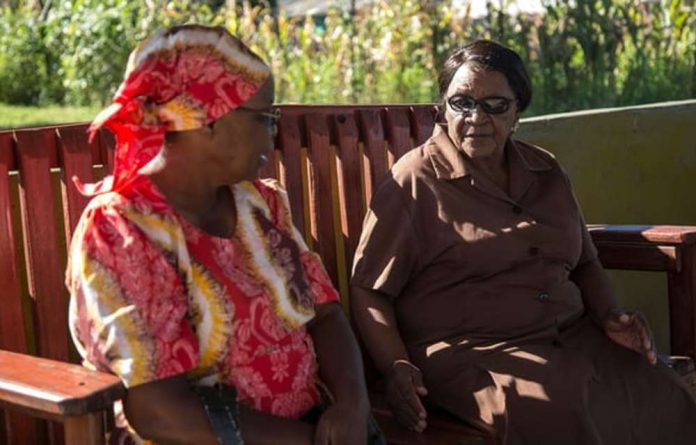 Grandmothers working with the Friendship Bench project chat before counselling sessions begin.