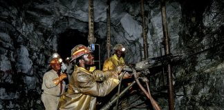Gold miners work the Cooke Shaft in Johannesburg. Thousands of gold miners and their families are now seeking compensation for the sector's failure to protect miners from silicosis
