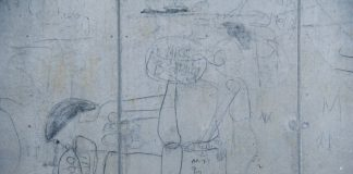 Graffiti on a wall in Diepsloot where a penis is likened to an AK47. The Sonke Change found that men are about three times more likely to rape or beat a woman if they are a problem drinker.