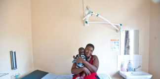 Happy Maifadi and her young son Enhle benefit from ongoing peer support from mothers2mothers.
