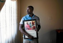 Heartbroken: Frans Makoetla holds a portrait of his mother