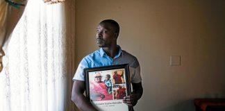 Heartbroken: Frans Makoetla holds a portrait of his mother