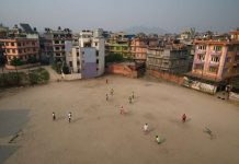 West African footballers practise at a ground in Naya Bazaar