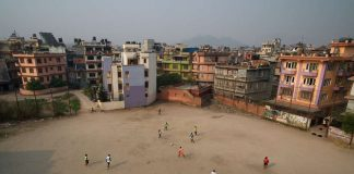 West African footballers practise at a ground in Naya Bazaar