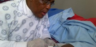 Health Minister Aaron Motsoaledi administers a contraceptive injection.