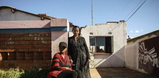 Jeanny Mbalati and her daughter Dinah outside their home in Soweto. It took them more than a year to get a loved one into a psychiatric hospital following his removal from Life Esidimeni facilities.