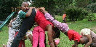 Chanda Mollers teaches yoga to Sister Abegail Nhleko's children.
