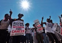 Activists gather at the offices of Roche in Johannesburg to protest against the high price of Herceptin