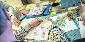 Some lower functioning Care Haven Psychiatric Centre residents are guided through drawing and reading with a staff member as part of a daily programme to keep them active
