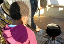 Helping hands: Zethu Mqopi* and her daughter Sisanda*. Zethu has learnt to carry out household chores