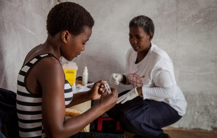 Community health workers didn't just provide at-home HIV testing. They went into schools to help teach young people sexual and reproductive health and encourage boys to get medically circumcised.