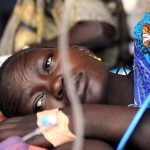 A Burundian woman is treated for malaria. Does Nigeria really account for almost a quarter of the world's malaria cases? Well...
