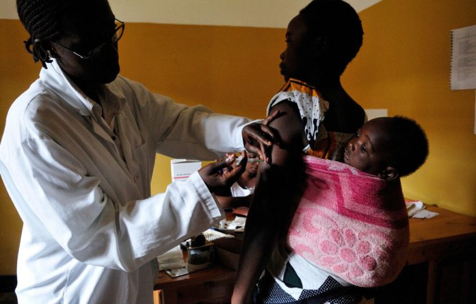 Life: Pelagie Nyirambarushimana and her child Francine Niyonshuti at the Central University Hospital of Kigali. Rwanda has made drastic improvements in reducing child mortality.