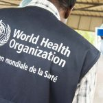 A World Health Organization official looks on as health workers in Conakry receive training during the 2015 Ebola outbreak in West Africa.