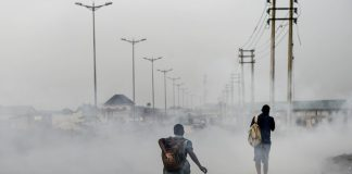 A smoky Port Harcourt street. Doctors have warned of the health-related consequences of the city's poisonous black soot.