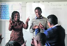 Bridging the gap: Pupils at the Emerald Hill School for the Deaf learning sign language. The majority of deaf people in Zimbabwe reportedly cannot read or write.
