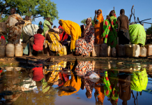 Water shortages in South Sudan force residents to rely on water vendors.
