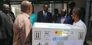 Congolese health ministry officials bearing the first batch of experimental Ebola vaccine are seen in Kinshasa