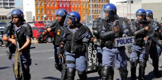 Police move to break up a protest. Experts say heavy-handed police tactics like these do nothing to stem drug abuse but harm reduction programmes might.