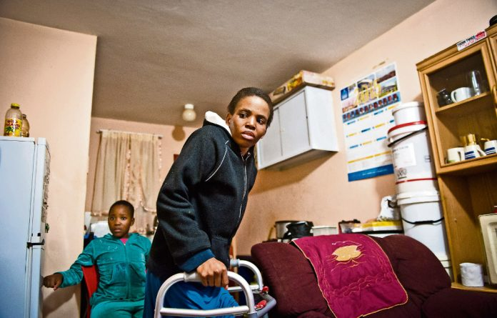 Despair: Lindiwe Mkwanazi didn't know what was wrong with her until a biopsy showed she had tuberculosis in her knee. She struggles to walk so her mother