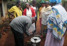 Keneth Ndua demonstrates his stove invention