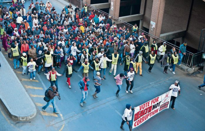 March against graft: Members of the Treatment Action Campaign protest outside the offices of the Free State health department in Bloemfontein last year.