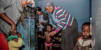 Home care: Community healthworker Nonqaba Melani weighs a child in Khayelitsha
