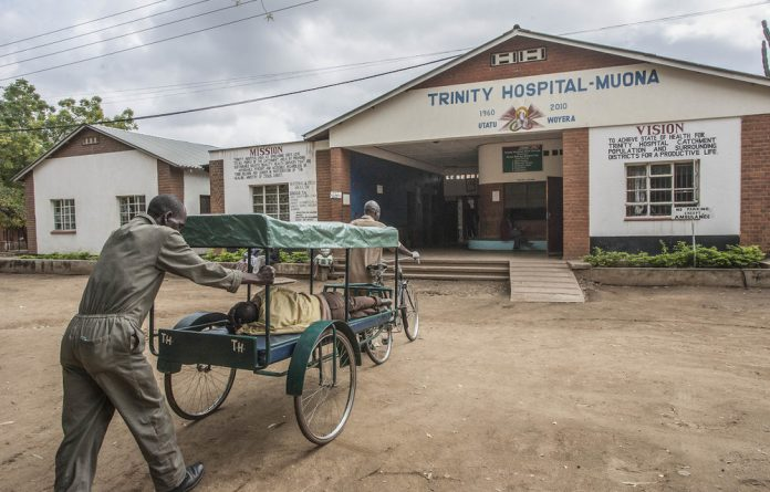 A bicycle ambulance arrives at Trinity Hospital in southern Malawi