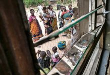 Women queue outside of a Malawian health facility for healthcare for their children. Moving rape crisis centres out of central hospitals in Malawi and into clinics closer to communities might increase the number of people who use them
