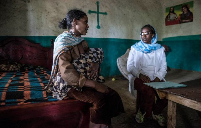 A health extension worker visits Brahini Mokonen at her home