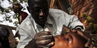 A Nigerian schoolgirl is vaccinated against polio during a mass nationwide polio inoculation.