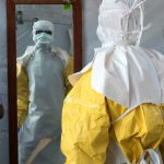 Man in Ebola protection suit.
