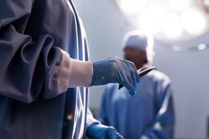 Doctor holding tweezers