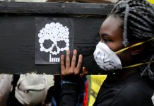 A campaigner in Nairobi carries a coffin during a protest against the construction of a coal plant in Lamu on Kenya's coast. (Baz Ratner, Reuters)