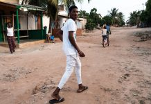 Man walking on a dirt road in Togo.
